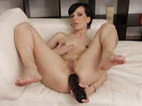 Dark haired Katy fills her asshole with huge toys and sucks her juices off them