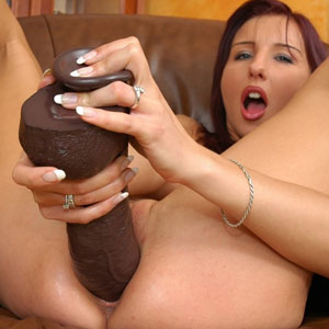 Olivia pounds a white and brown brutal dildo
